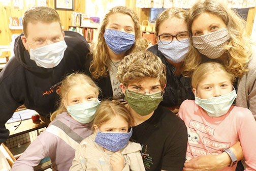Volunteers in Diocese of Gary sewing medical masks while at home