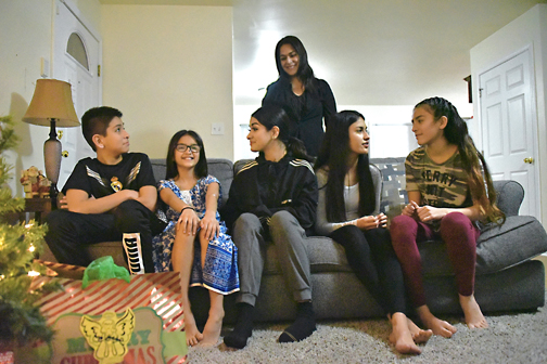 TABOR HOUSE OPENS Family getting 'a hand up' as first occupants of Catholic Charities home